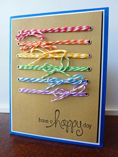 Rainbow twine through eyelets - easy and colorful.