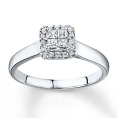 Four princess-cut diamonds come together to create a grand look in this beautiful engagement ring.