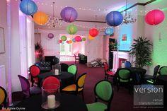 Oakwood House, Kent.  Brightly coloured hanging lanterns with fairy lights. www.weddingcreative.co.uk