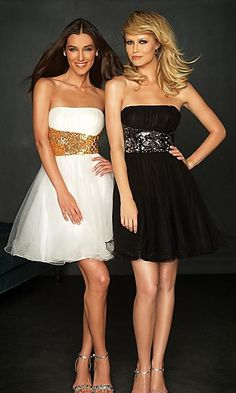 Semi Formal Dresses.       I like the white with gold much better than the black with what looks like silver.