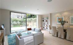 Open plan living room with 2 panel set of sliding RAL 9007 doors. #slidingdoors #falham