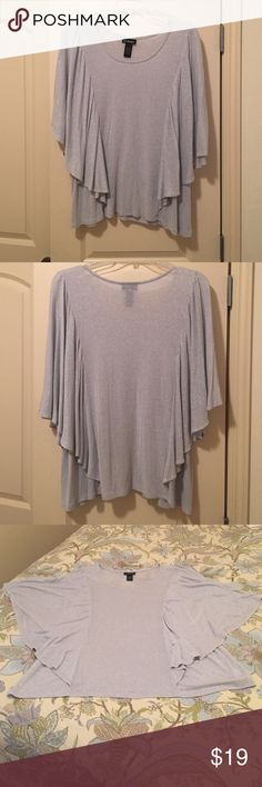 Lane Bryant Batwing Sparkly Top✨✨✨ This batwing top is great for dressing up. The silver metallic material pairs well with dark denim or fancier dress pants/skirts. The material is a nylon/rayon blend with metallic thread that makes it sparkle. Only worn once for a party. It's a size 18/20. Lane Bryant Tops Blouses