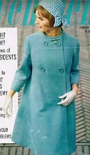 """The cover of the magazine features this beautiful blue coat described as having a """"baby-doll look"""", with empire waist, flared skirt, double-breasted closing, and slender bracelet length sleeves"""