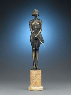 "This stunning figure by Austrian Art Deco sculptor  Bruno Zach (1891-1935), entitled Easy Rider, is one of this iconic artist's celebrated ""Riding Crop"" figures. Fine Art Sculpture ~ M.S. Rau Antiques"