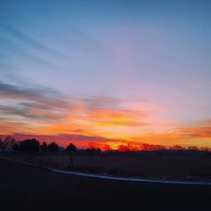 Are you up yet?! Good morning! ---- Armed with only my phone sticking out of a moving car; this is as close as I could get to how awesome the sunrise actually looked. It's definitely still blown out and not wide enough. Wish I would've had the the 5D.
