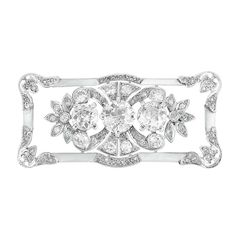 Belle Epoque Platinum and Diamond Brooch  3 old European-cut diamonds ap. 1.90 cts., 8 diamonds ap. .40 ct., c. 1905, ap. 8 dwt.