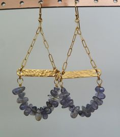 Stunning iolite curves below a hammered 14k gold-filled bar. The earring hangs from lovely brushed link 14k gold-filled chain.  The earrings hang