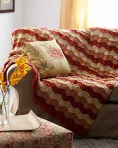 Wave pattern knit afghan.