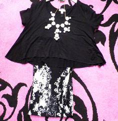 Black Shirt: $21.95 Palazzo pants: $33.95 White necklace: $24.95