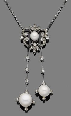 A pearl and diamond pendant necklace The openwork cartouche set to the centre with a 5.5mm pearl, within a surround of brilliant and rose-cut diamonds, suspending two articulated knife-edge bars set with brilliant-cut diamonds, each terminating in a 7.2mm or an 8.3mm pearl, to a trace-link chain, brilliant-cut diamonds approx. 0.35ct total, lengths: pendant 5.4cm, chain 38.4cm. Edwardian or Edwardian style.