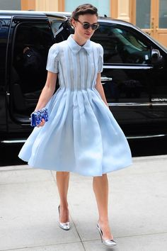 Beautiful Keira Knightly reminds me of Audrey Hepburn in this powder blue dress and sunglasses.