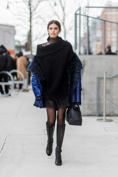 Model Sara Sampaio wearing a black knit sheer dress tights black boots outside Tory Burch on February 14 2017 in New York City Nyfw Street Style, Model Street Style, Cool Street Fashion, Love Fashion, Fashion Looks, Fashion Outfits, Winter Fashion, Sara Sampaio, Fresh Outfits