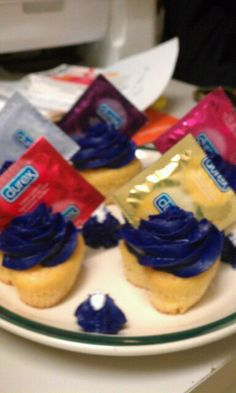 Condom cupcakes that I made for a friends birthday to go with her penis birthday cake! (yes, they are real condoms)