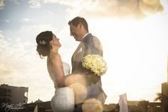 Bride and groom sunset beach portraits at Gran Caribe Real Cancun, Mexico by Magic Art Wedding Studio