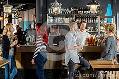 Ordering Drinks At The Bar Royalty Free Stock Photos - Image: 16208968