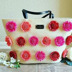 """Kate Spade Montigo Avenue Annabette Straw Tote NWT Perfect Summer Vacation or Pool Day Large Tote. Hot Pink, Coral & Red Flowers against a cream straw background. Black leather handles can be worn over the shoulder, 9.5"""" Strap Drop 2 Interior slip pockets & 1 large zipper pocket. Black leather magnetic snap closure. Large enough to carry towels, sunscreen and much more. kate spade Bags Totes"""