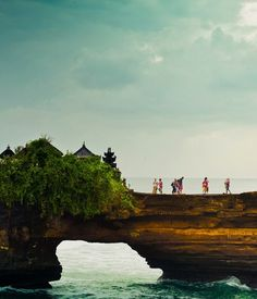 Temple walk in Bali, Indonesia. Wouldn't it be amazing to hang a hammock in that perfect lil nook above the water?