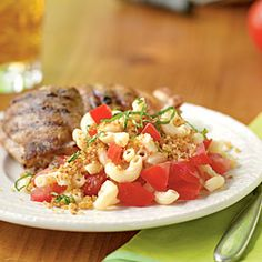 White balsamic vinegar, tomato, and basil help this side dish maintain its fresh appeal. Click here for more macaroni salad recipes.