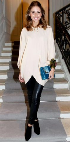 Look of the Day › January 24, 2012 WHAT SHE WORE Palermo sat front row at the Dior haute couture show in leather leggings and a tulip hem blouse that she accessorized with a gold statement necklace, feathered cuff, turquoise clutch and black booties