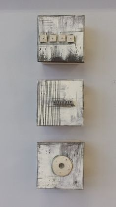 Marks, Texture, and Wire by Lori Katz. Slab-built stoneware with slips, underglaze, high-temperature wire, and glaze. Backed with wood. Each square is wired to hang simply from a picture hook. Hanging template and picture hooks included with purchase.