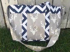 Navy Blue Deer Diaper Bag/Deer Diaper Bag/Antler Diaper Bag/Navy Blue Diaper Bag/Personalized Name Embroidered Diaper Bag by SewSweeterBaby on Etsy https://www.etsy.com/listing/452489478/navy-blue-deer-diaper-bagdeer-diaper