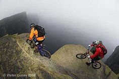 Hans Rey and Steve Peat cycling illegally inches from the death on the Cliffs of Moher - pic by Victor Lucas