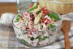 L' insalata di riso philadelphia tonno e pomodori e' un primo piatto estivo sfizioso e veloce con tanti ingredienti saporiti
