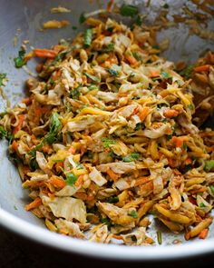 Chopped Thai chicken salad:  2 boneless skinless chicken breasts; 1 small head green or white cabbage (2 cups shredded); 1 large carrot (1½ cups shredded); 1 green papaya (1½ cups shredded); ½ cup fresh cilantro; ½ cup green onions; ½ cup chopped peanuts.  Dressing:  2 cloves garlic; 3 bird's eye chili peppers (sub ½ teaspoon minced hot pepper); 2 T soy sauce; 2 T vinegar; 2 T sugar; 1 T fresh lime juice; 1 T oil; ½ tsp fish sauce; ¼ cup peanut butter; ¼ cup water.