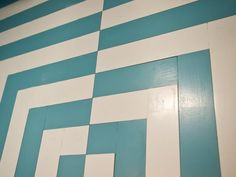 "Slats of poplar wood were puzzle-pieced together to create an eye-catching geometric wall pattern. Wood was then primed and painted before final installation.  (See my ""A few of My Favorite Things"" board for full look.) HGTV Smart Home 2013"
