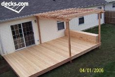 Nice simple deck with half covered in pergola plus box seat. Nice simple deck with half covered in