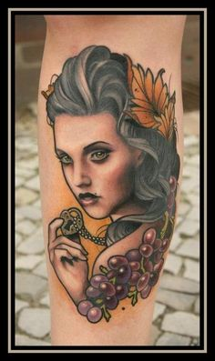 Tattoo of girl with heart locket, grapes.  Neo traditional style.    done by daniel gensch