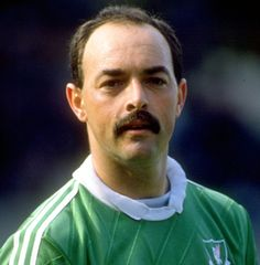 The original eccentric genius between the sticks, Bruce Grobbelaar will be best remembered for the wobbly-legged penalty heroics which brought Liverpool the 1984 European Cup and inspired Jerzy Dudek to the same feat in Istanbul 21 years later.    Read more about Brucie here: http://www.liverpoolfc.tv/history/past-players/bruce-grobbelaar