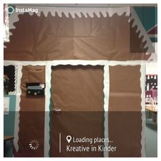 Turning school hallway into gingerbread houses!