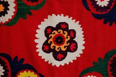 detail of VINTAGE SUZANI THROW EMBROIDERED TEXTILE FROM UZBEKISTAN IN CENTRAL ASIA