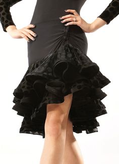 Lumiere Boogie Woogie Latin Dance Skirt S2. Designer short skirt with floral crimped band creates an fantastic look. Bulit-in-pants is attached. Available in Blk w/ Blk Polka Dots, Blk w/ Purple Polka Dots, Blk w/ Red Polka Dots and Purple w/ Purple Polka Dots. Perfect for Latin dancing practice and performance.