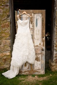 rusty love vintage rentals farm door hanging wedding gown Pro Advice: Vintage Wedding Décor Rentals