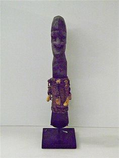 Asmat ceremonial axe with carved timber figure and stone Jadeite axe head with various shell decorations and raffier binding on muse...