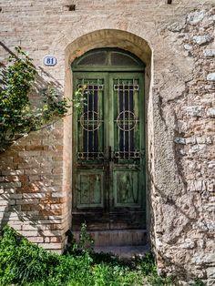 Photograph Green door by Fabio Boccuzzi