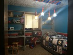 Sports theme bedroom. Built in shelving/desk/bed