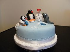 Pingu the Penguin and friends ice fishing Christmas cake.  Credit: Makeybakeycakey, Nottingham
