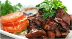 BBQ Pork:Slices of tender pork marinated with garlic and spices grilled and served with spicy lime sauce from Nariya Thai Restaurant in Blvd, Los Angeles #Food #BBQ forked.com