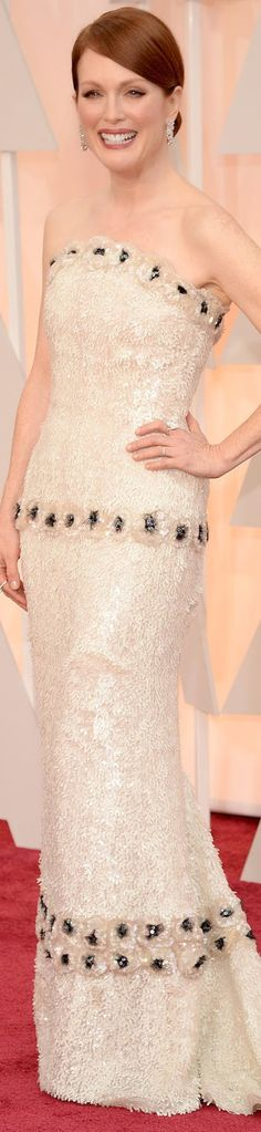 The Best Actress Oscar Winner Julianne Moore looks elegant in a floral and pearl appliqué couture gown by Chanel. 2015 Oscar Red Carpet