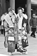 """Slightly embarrassed girls photographed at Tokyo's Meji Shrine on """"coming of age day"""" in Japan."""