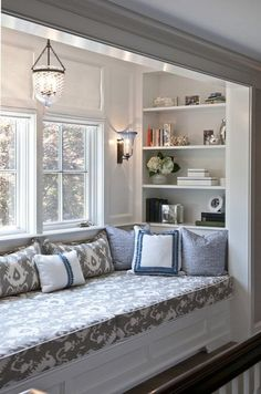 Twin size bed in a window seat....built-in bookcases facing in.....maybe under a dormer....instant guest room...