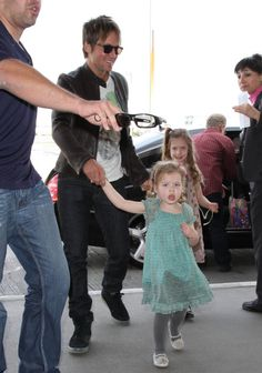Keith Urban departs a flight at LAX Airport with his daughters Sunday and Faith on March 7, 2014