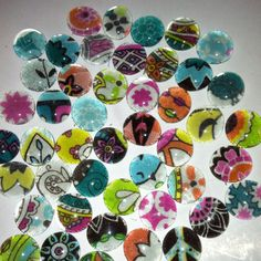Magnets! So easy! Just mod podge fabric on the flat side of glass gems!