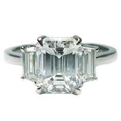 2.06 Carat Emerald Cut Diamond Platinum Engagement Ring   From a unique collection of vintage engagement rings at https://www.1stdibs.com/jewelry/rings/engagement-rings/