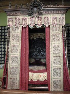 Ornate red canopy bed at the Chateau de Chambord.