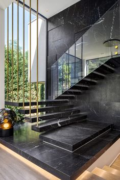 Ideas - This modern house has marble stairs with a glass handrail, that travel past a large floor-to-ceiling window.Stair Ideas - This modern house has marble stairs with a glass handrail, that travel past a large floor-to-ceiling window. Glass Handrail, Stair Handrail, Home Stairs Design, Staircase Design Modern, Luxury Staircase, Stair Design, Staircase Ideas, Glass Stairs Design, Modern Ceiling Design