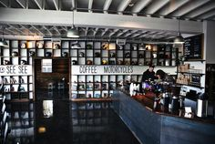 To be filed under Only in Portland (Oregon, that is): The biker bar reimagined as a coffee roastery/motorcycle shop.